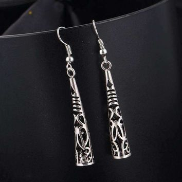 Cut-Out Tribal Horn Dangling Earrings