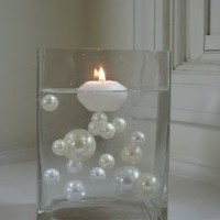 Wholesale Unique Elegant Vase Fillers - 34 Jumbo Ivory Pearl Beads and White Pearl Beads - The Transparent Water Gels that are floating the Pearl Beads are sold separately.