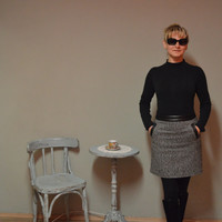 Elegant skirt, black and white coloring, straight silhouette,eco-friendly, with leatherette accents.