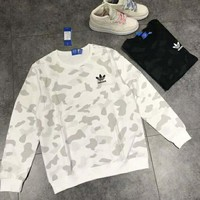 Adidas Autumn and winter new fashion bust side letter leaf print camouflage couple long sleeve sweater top White