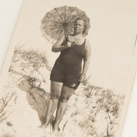 Woman on beach/sea bank and parasol, antique photo, snapshot 1934, Europe