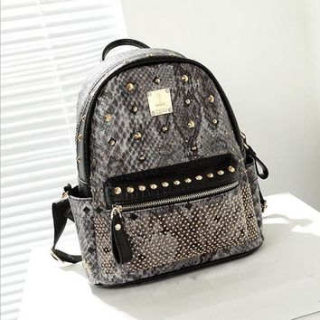 2017 Fashion Brand Design Women PU Serpentine Leather Rivet Backpack School Teenager Girl Travel Bag Mochila