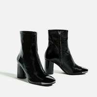 HIGH HEEL LEATHER ANKLE BOOTS WITH METALLIC TOE DETAILS