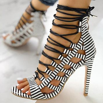 Summer new style cross straps snake print stiletto high-heeled large size female sandals