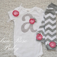 Baby Girl Chevron Initial Bodysuit with a pink rose, Matching flower headband, and Grey and white Chevron Leg Warmers set