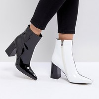 Public Desire Chaos Black and White Contrast Ankle Boots at asos.com