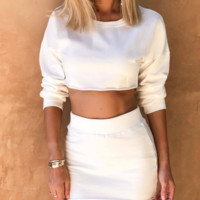 Hot selling sexy round collar, midriff-baring long sleeve hoodie skirt two-piece suit