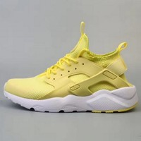 NIKE AIR HUARACHE Fly line Wallace 4 generation men and women leisure shoes yellow Tagre™