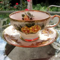 Yellow Roses decorate this China Teacup and Saucer