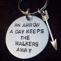 "Zombie undead walking dead inspired keychain ""An arrow a day keeps the walkers away."""