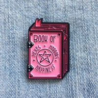 """""""Book of Hexes, Horrors, and Happiness"""" Pink Grimoire Enamel Pin"""