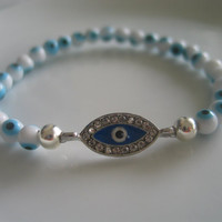 Blue and silver colored evil eye charm bracelet