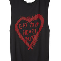 Black muscle tee with open back and red eat your heart out print