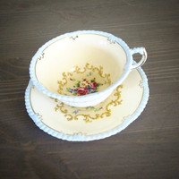 Antique Paragon tea cup and saucer floral needlepoint design and beaded edge, footed English bone china teacup, peach tea set