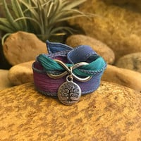 Tree infinity wrap bracelet with silk ribbon and charms. Great gift for yogi enthusiasts.