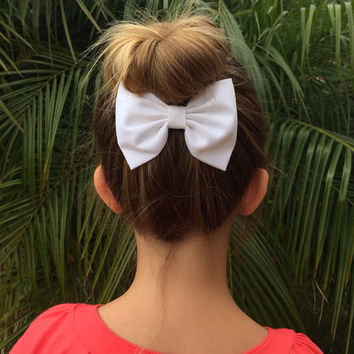 Beautiful, handmade white cotton hair bow from Seaside Sparrow.  Perfect gift for any girl.