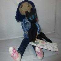"Hand made doll ""Coraline"" to the cat. The heroine of the animated film ""Coraline"""