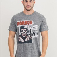 Featuring tri-blended super soft men's tee with Horror Business Misfits & Logo Print on front, crew neckline, short sleeves.