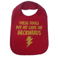 These fools put my cape on backwards baby bib infant toddler boy / girl / unisex funny superhero shower gift -  red and yellow