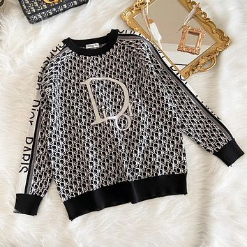 Dior the latest big letter all over print sweater