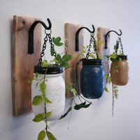 Individual Hanging Painted Mason Jar Wall Decor mounted to recycled wood board with wrought iron hooks