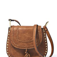 This gorgeous vegan leather saddle bag, features gold tone studded hardware, woven braided detailing around the flap with magnetic button closure, dangling fringe tassel attached on flap, distressing detailing, and an adjustable crossbody strap. Zip and sl