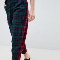ASOS DESIGN bree trousers in mixed check at asos.com