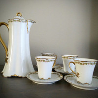Haviland Limoges France for Hess Bros Allentown, PA chocolate set. Tea pot and 4 cups with saucers, chocolate cups, French tea cups