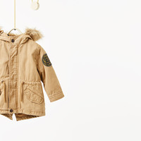 Parka with detachable lining