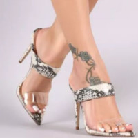 Hot style is a big seller of simple PVC stiletto slippers with clear heels