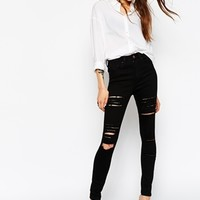 ASOS Ridley High Waist Ultra Skinny Jeans in Clean Black with Extreme Rips and Busts at asos.com