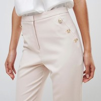 ASOS DESIGN slim trousers with button pocket detail at asos.com