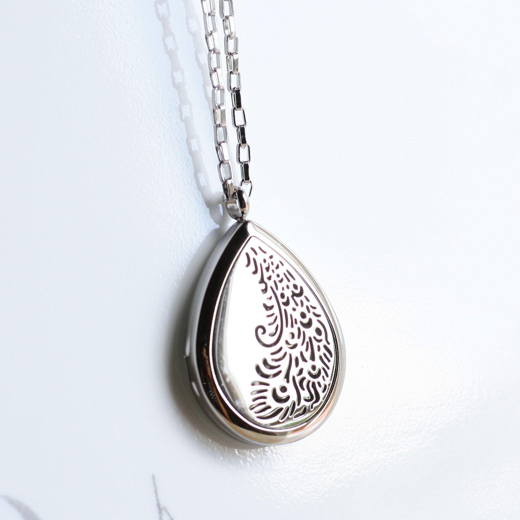 """Image of Aromatherapy Essential Oil Diffuser Necklace - Stainless Steel Jewelry - Hypo-allergenic 316L Surgical 30 mm Locket Pendant with 24"""" Chain & 3 Washable Pads (Model Peacock)"""