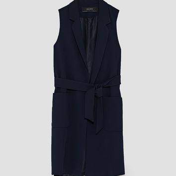 WAISTCOAT WITH LAPELS AND BELT DETAILS