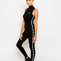Puma Exclusive to ASOS High Neck Jumpsuit at asos.com