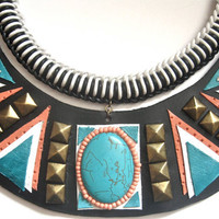 statement studded bib necklace in black, white, turquoise and coral with brass hardware.