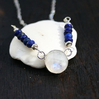 Moonstone and lapis lazuli necklace with sterling silver setting, beads and chain. Round faceted moonstone pendant with blue lapis lazuli.