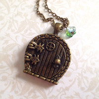 Hobbit Home Locket Necklace. Lord of the Rings. Brass. Vintage Style. Fairy Door. Opening Door. The Shire. Bilbo. Woodland. Green Flower.