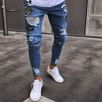 Distressed Ripped holes Badge hombre Slim Fit jeans
