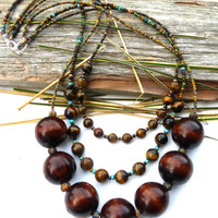 Chunky wood, seed bead, and tigers eye stone chunky necklace.