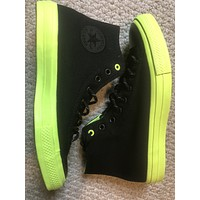 Black with lime bottom all star chuck Taylor's converse sz11
