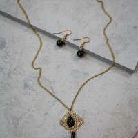 Small Black Tassel Necklace and Earring Set in Gold