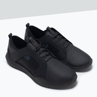 ASYMMETRICAL COMBINED TRAINERS