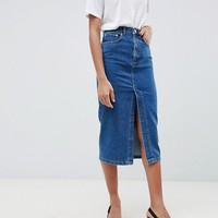 ASOS DESIGN denim midi skirt with split front in midwash blue at asos.com