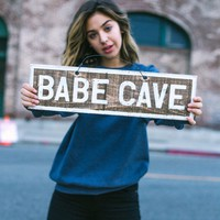 Babe Cave Vintage Sign
