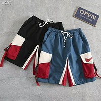 NIKE 2018 new summer loose multi-pocket contrast color stitching streamers five pants F-AG-CLWM