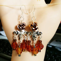 brown rose cross chandelier earrings brown beaded dangles handmade bead jewelry