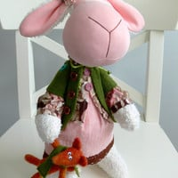 Sweet pink sheep - a symbol of a 2015 - with a little red fox