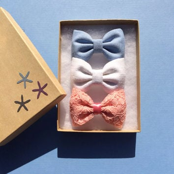 Vintage coral lace, blue chambray, and white linen hair bows from Seaside Sparrow. Our vintage coral lace is limited and beautiful.