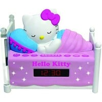Officially Licensed Hello Kitty KT2052 Alarm Clock Radio with Bed Post NIGHT LIGHTS! Wake to Radio or Alarm ~ Large, Easy to Locate Snooze Button ~ Two Bedposts Light Up for Night Light (On/Off Switch) ~ Built in cord ~ Battery Backup ~ This pink alarm clo
